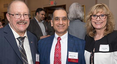 ​John Bartlett, MS, PhD; Shereen Azer, BDS, MSc, MS; and Lisa A. Lang, DDS, MS, MBA at the reception