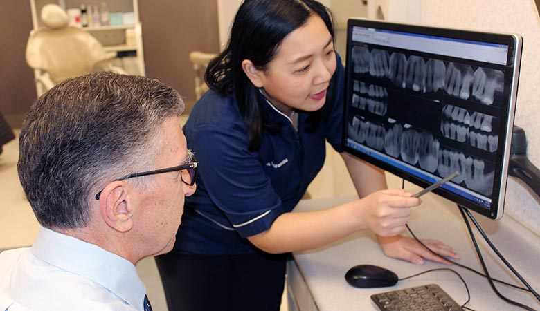 Faculty and resident confer in the Periodontology Clinic